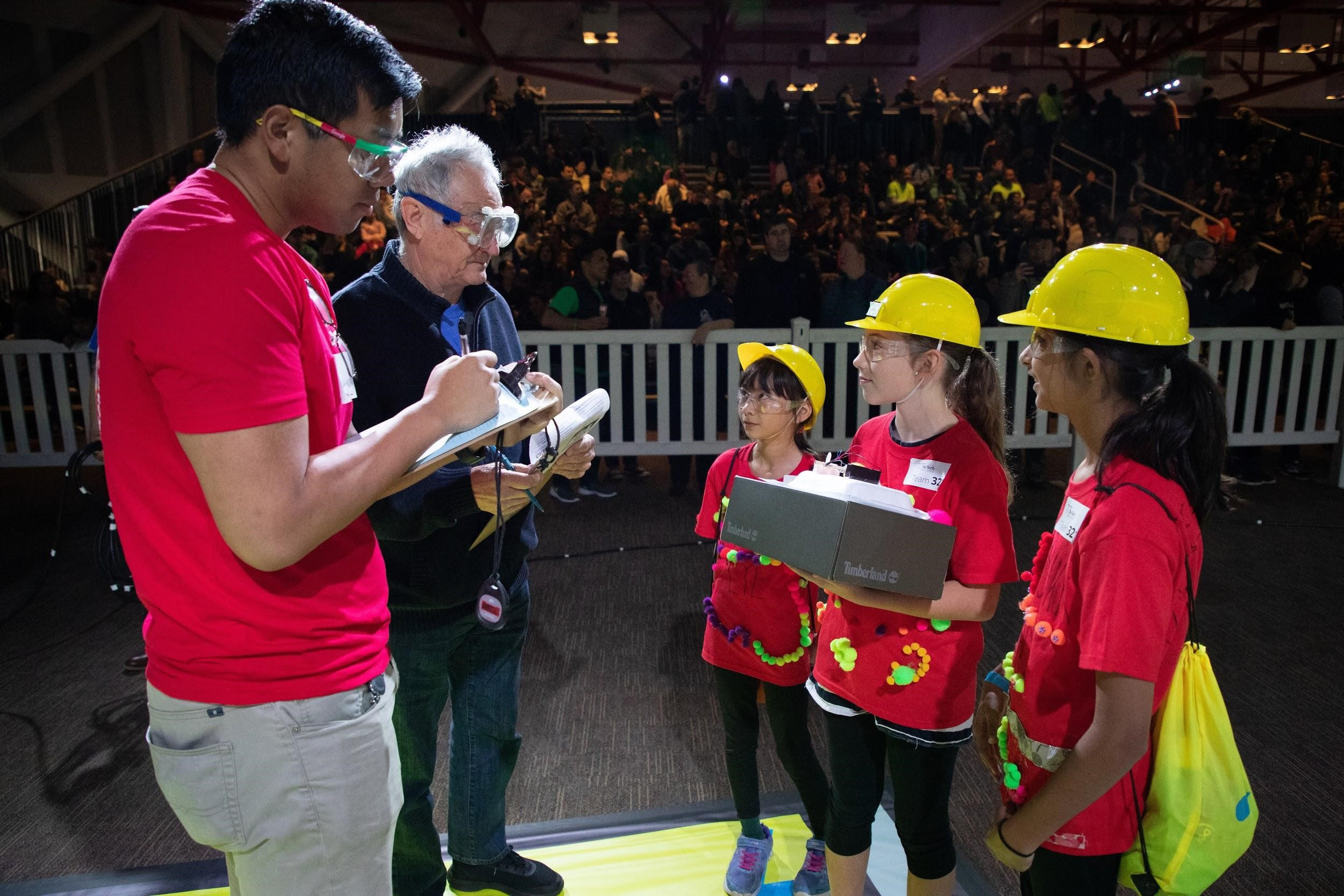 Judges interview a team during The Tech Challenge showcase