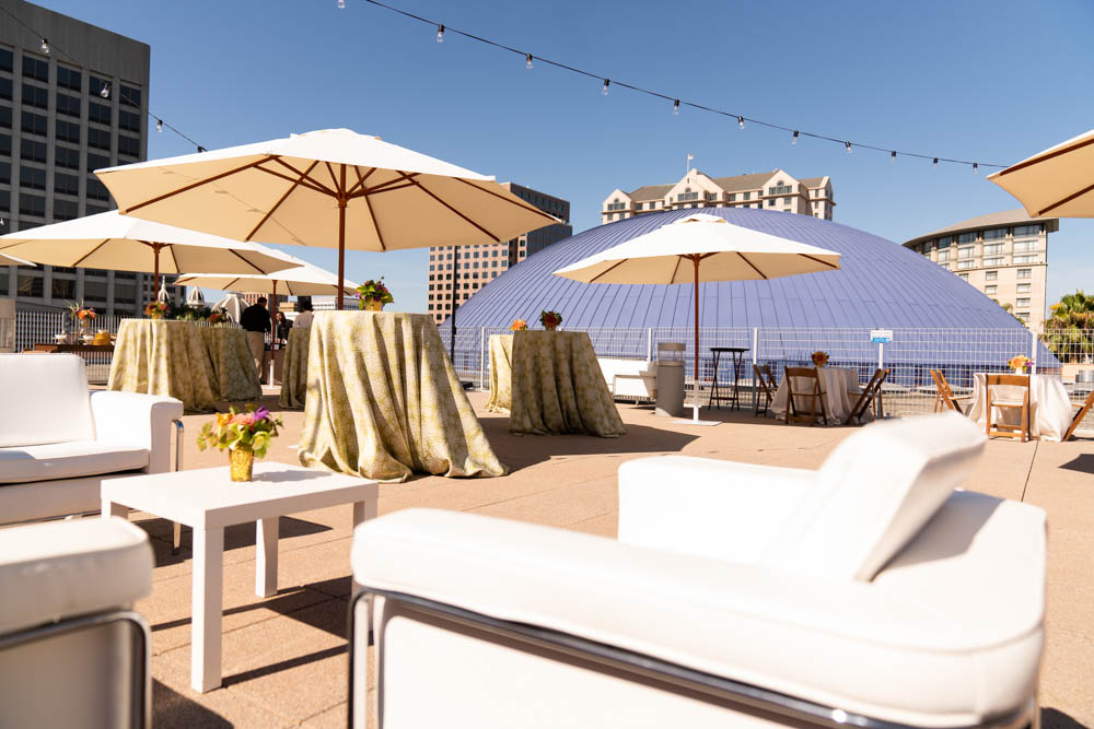 The Tech Interactive's rooftop terrace with outdoor seating, tables and umbrellas.