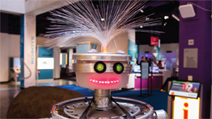 Buster the robot smiles at visitors.