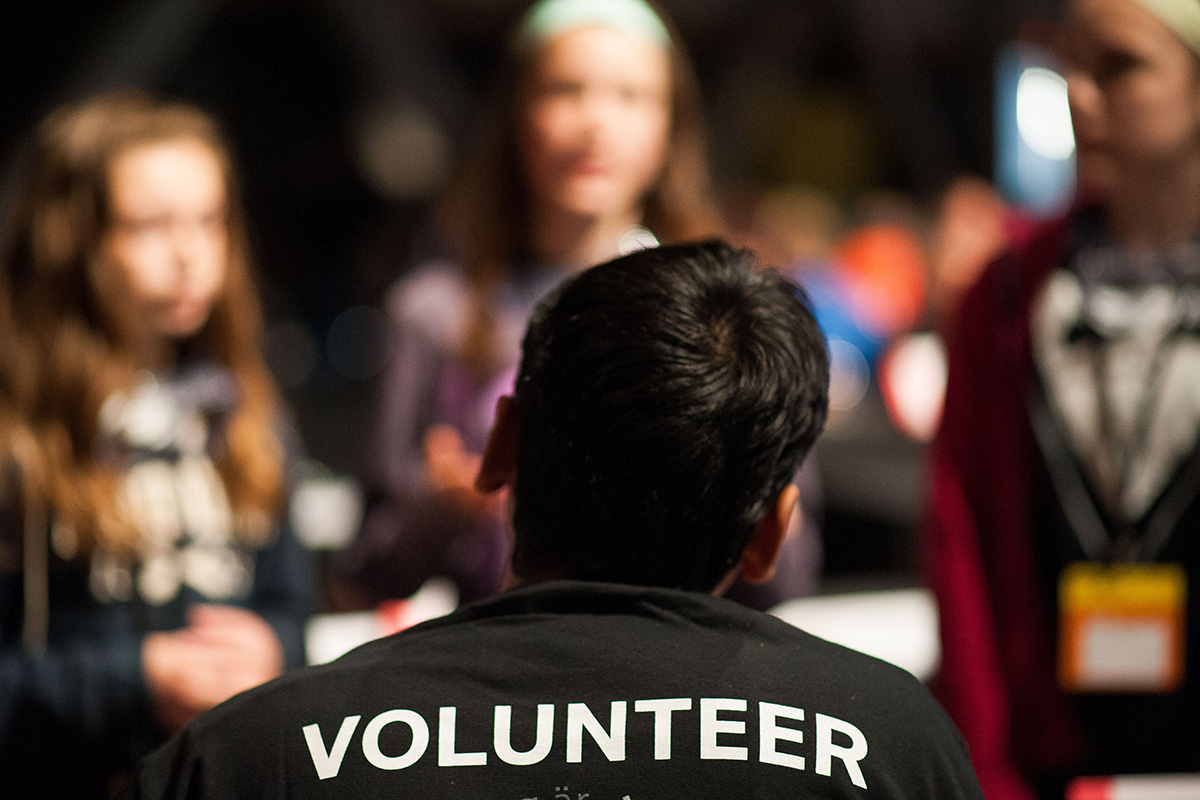 A volunteer at the tech challenge showcase