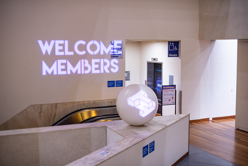 """Wall projection of text reading """"Welcome Members"""""""